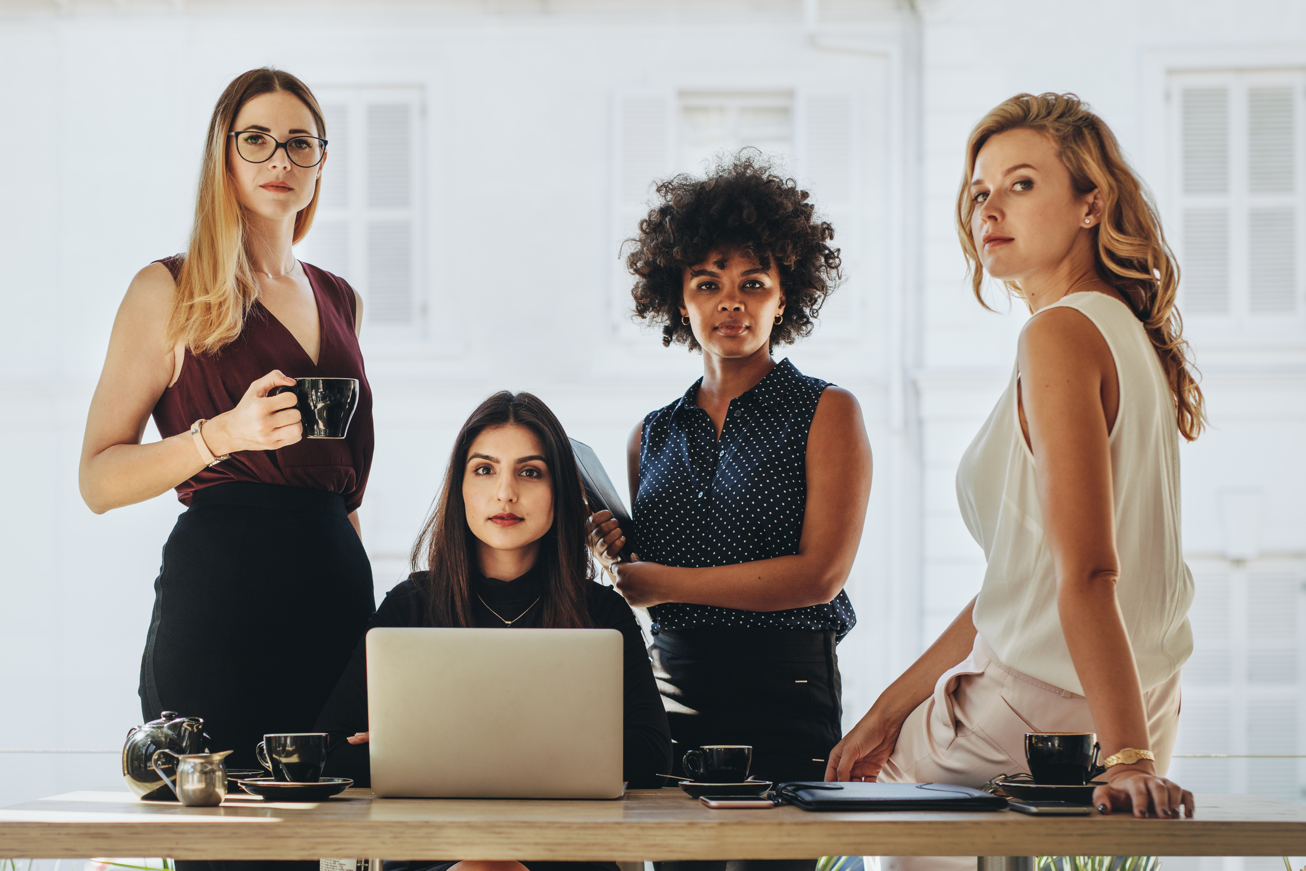 Group,Of,Multiracial,Businesswomen,In,Casuals,Together,At,Office,Desk